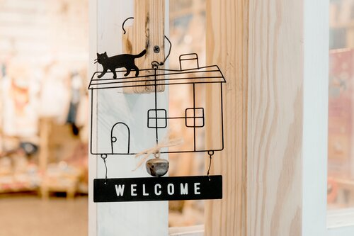 Art showing a welcome sign for a small business.