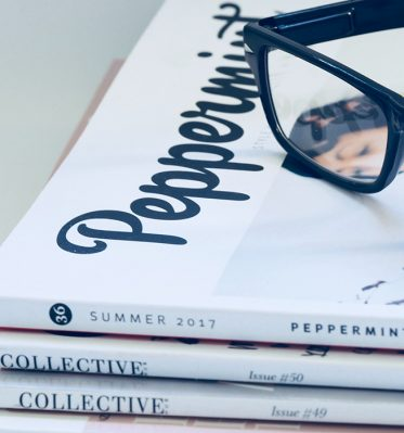 Black glasses are placed on top of Peppermint magazine.